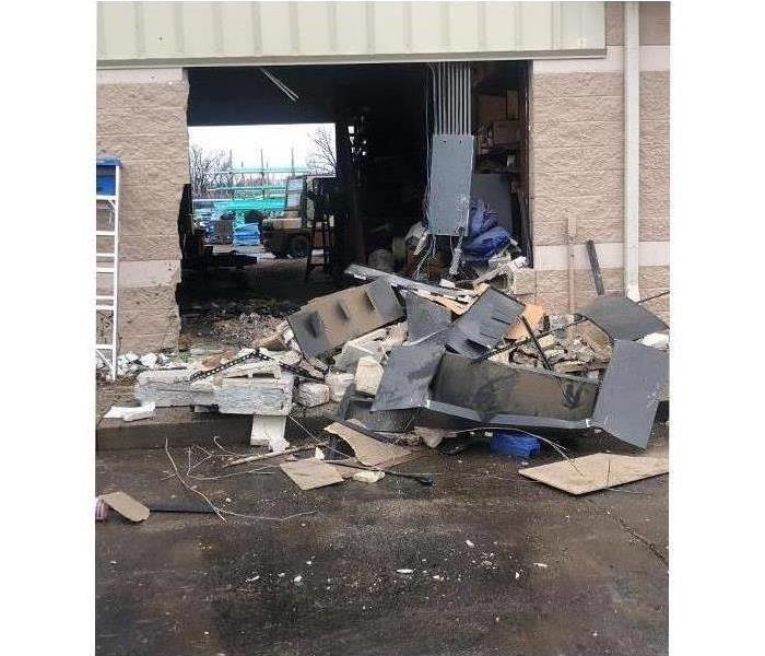 Before SERVPRO recon team restored building after car crashing into it