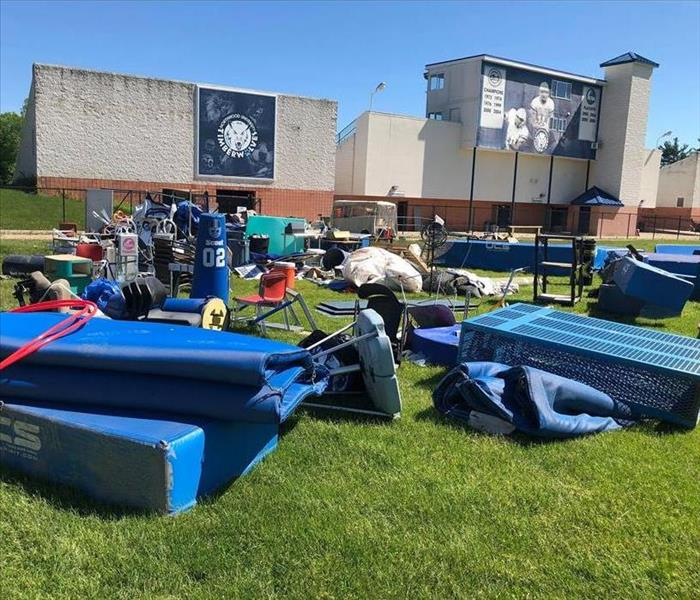 Football equipment laying outside of field after flood
