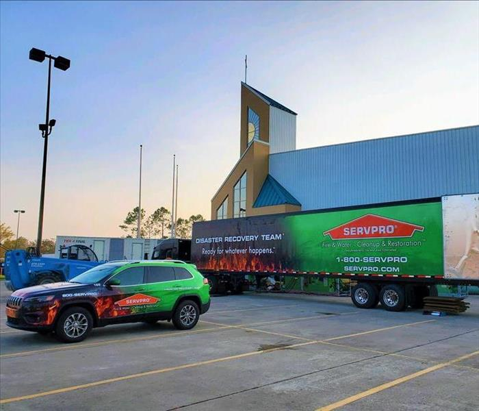 SERVPRO jeep and semi outside of church