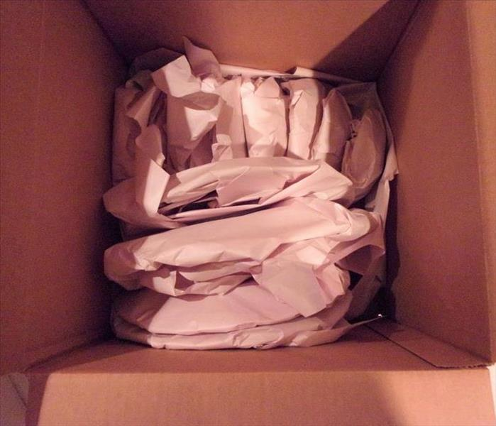 A box of nicely packed belongings after a loss
