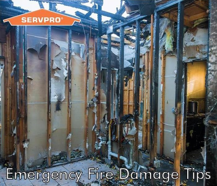 House with fire damage with SERVPRO logo