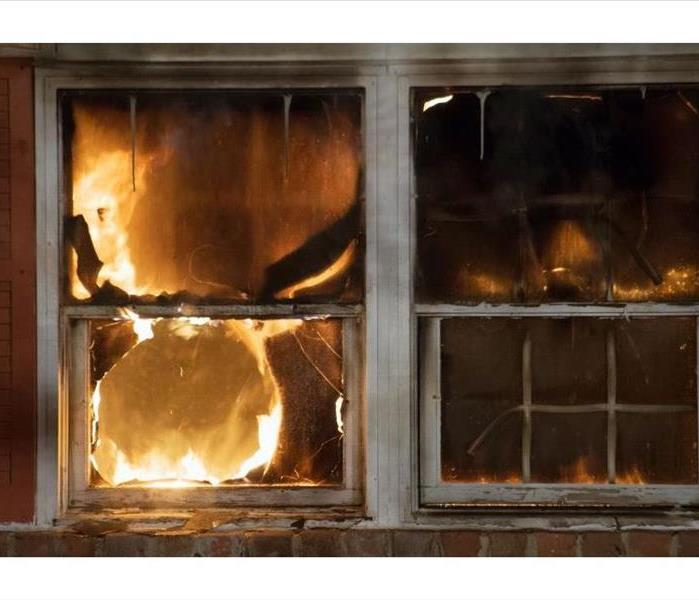 Flame devouring windows of home