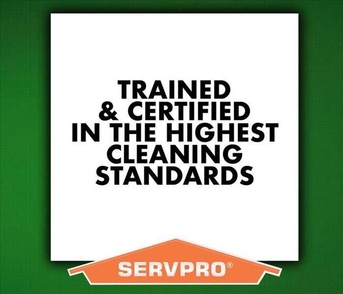 "Green background with ""Trained and Certified In The Highest Cleaning Standards"" with SERVPRO logo"