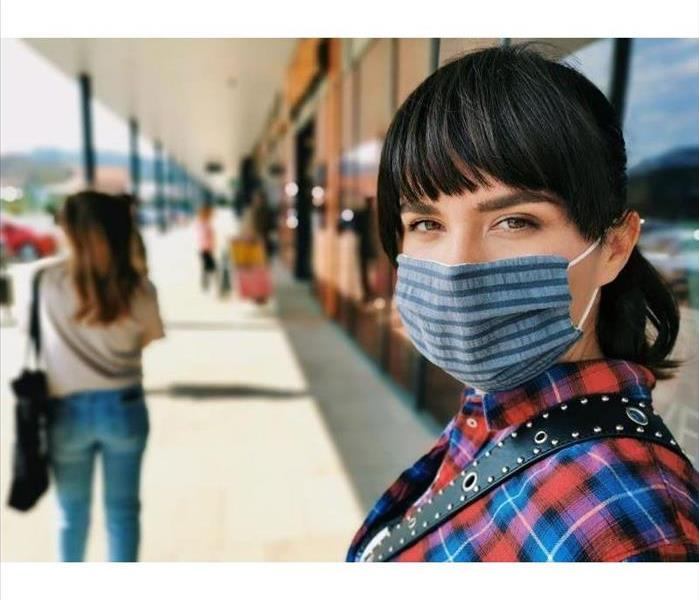Woman wearing mask with shopping