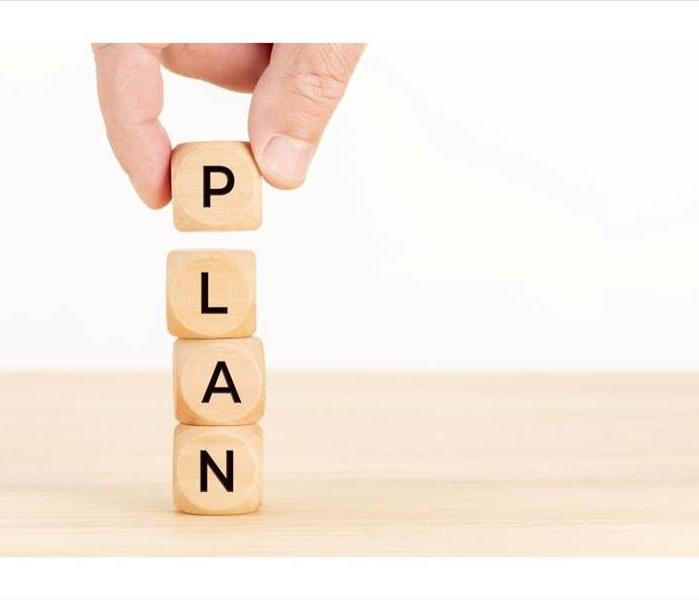 """Plan"" spelled out in block letters"
