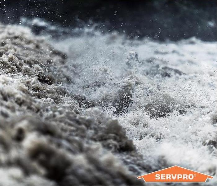 Close up of rushing waters with SERVPRO logo