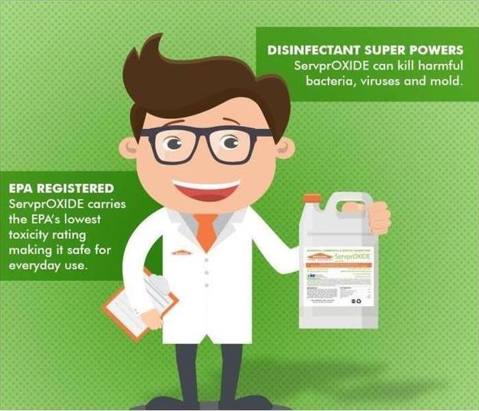 SERVPRO employee in lab coat holding SERVPROxide