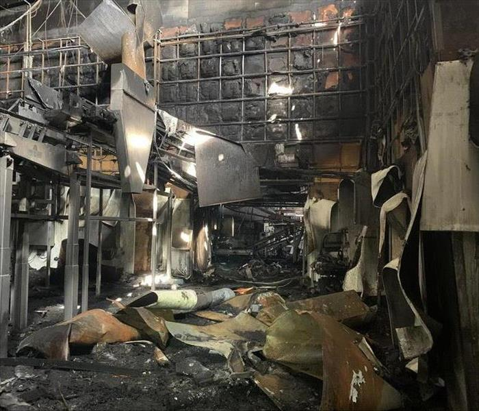 Inside of facility with severe fire damage